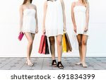 three sexy woman in shopping... | Shutterstock . vector #691834399