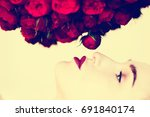 beautiful model and flowers.... | Shutterstock . vector #691840174