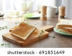 wooden board with tasty... | Shutterstock . vector #691851649