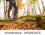 hikers boots on forest trail.... | Shutterstock . vector #691861423