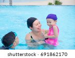 asian mother and her children... | Shutterstock . vector #691862170