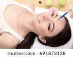 hands of cosmetologist making...   Shutterstock . vector #691873138