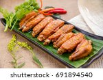 fried chicken wings with fish... | Shutterstock . vector #691894540