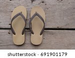 Brown Slippers On Wooden Floor
