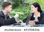 business men and women talking... | Shutterstock . vector #691908346