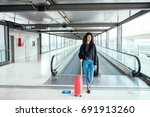 woman in the moving walkway at... | Shutterstock . vector #691913260