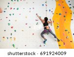 woman climbing on the wall ... | Shutterstock . vector #691924009