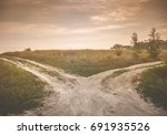 fork in the road. a country... | Shutterstock . vector #691935526