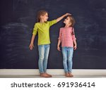 two children sisters play... | Shutterstock . vector #691936414