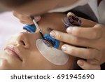 cosmetic procedure of dyeing... | Shutterstock . vector #691945690