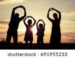 happy family standing in the... | Shutterstock . vector #691955233