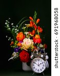 a silver alarm clock and a vase ...   Shutterstock . vector #691968058
