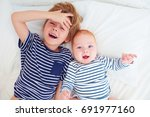 portrait of funny brothers... | Shutterstock . vector #691977160