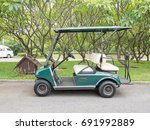 side view of golf car with... | Shutterstock . vector #691992889