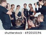 photographers paparazzi take... | Shutterstock . vector #692010196