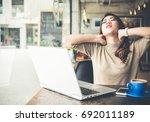 young beautiful asian woman... | Shutterstock . vector #692011189