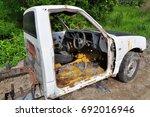rusty abandoned mini truck in... | Shutterstock . vector #692016946