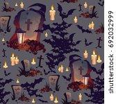 seamless halloween pattern with ... | Shutterstock .eps vector #692032999