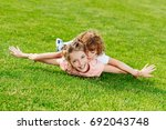 adorable brother and sister... | Shutterstock . vector #692043748