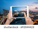 hand holding smart phone use ar ... | Shutterstock . vector #692044423