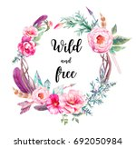 Stock photo watercolor boho chic eucalyptus and tree branches wreath with flowers bouquet arrows and feathers 692050984