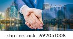 business handshake and business ... | Shutterstock . vector #692051008