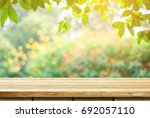 empty wooden table over blurred ... | Shutterstock . vector #692057110