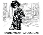 fashion girl on a street... | Shutterstock .eps vector #692058928