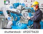 engineer using laptop computer... | Shutterstock . vector #692075620