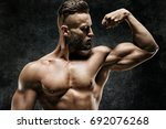 athletic man showing his bicep. ... | Shutterstock . vector #692076268