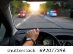police on the road controls the ... | Shutterstock . vector #692077396