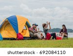 group of camping tourist enjoy... | Shutterstock . vector #692084110