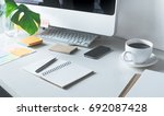 worktable with computer and... | Shutterstock . vector #692087428