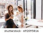 indoor portrait of two stylish... | Shutterstock . vector #692095816
