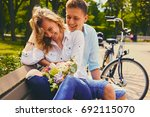 attractive young couple on a... | Shutterstock . vector #692115070