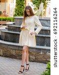 beautiful woman posing in a coat | Shutterstock . vector #692116264