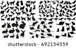 Stock vector vector isolated silhouette of rat cats and rabbits dog and doves collection 692154559