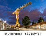 yellow crane by night  nantes ... | Shutterstock . vector #692169484