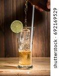ice tea glass on wooden table | Shutterstock . vector #692169529