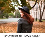Young Woman Walking On Autumn...