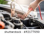 close up of hand charging car... | Shutterstock . vector #692177050