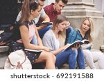group of students reading on...   Shutterstock . vector #692191588