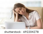 bored sleepy businesswoman... | Shutterstock . vector #692204278