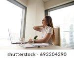 tired businesswoman feeling... | Shutterstock . vector #692204290