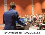 speaker giving a talk on... | Shutterstock . vector #692205166