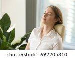 calm attractive woman feeling... | Shutterstock . vector #692205310