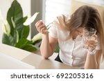 sick businesswoman holding... | Shutterstock . vector #692205316