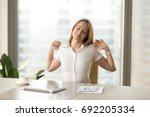 happy businesswoman stretching... | Shutterstock . vector #692205334