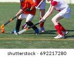 children playing field hockey... | Shutterstock . vector #692217280