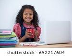 portrait of smiling... | Shutterstock . vector #692217604